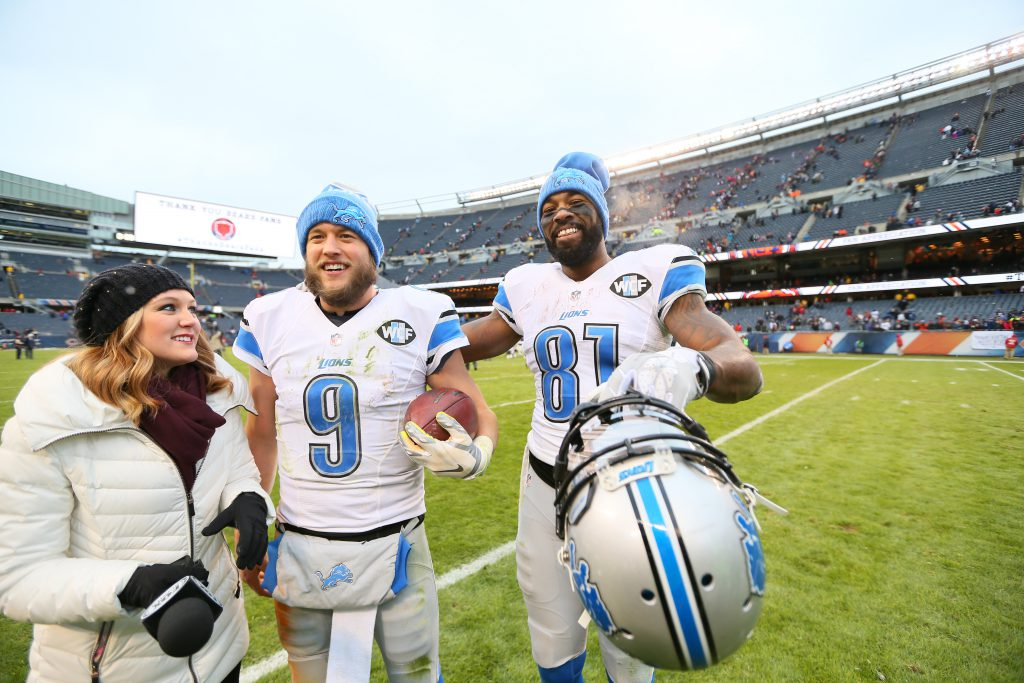 Waiting to interview Matthew Stafford as he congratulates Calvin Johnson on what could be his final game as a Lion