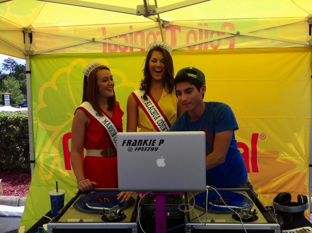 Learning to DJ at the Pollo Tropical Grand Opening with her sister queen Miss Alachua County USA Rachel Jardine