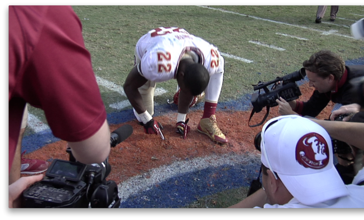 FSU player cuts turf from Florida Field while UF band plays Alma Mater